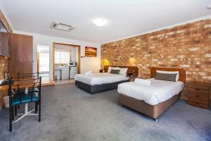 A bed or beds in a room at Clare Central