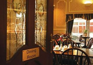 A restaurant or other place to eat at Barton Villa