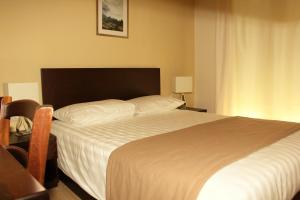 Un ou plusieurs lits dans un hébergement de l'établissement Rea Hotel