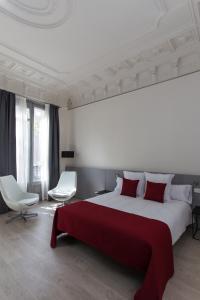 Cama o camas de una habitación en Izaila Plaza Catalunya
