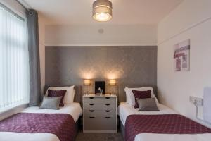 A bed or beds in a room at The Fountaindale Skegness