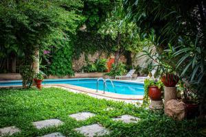 The swimming pool at or near Casa del Balam