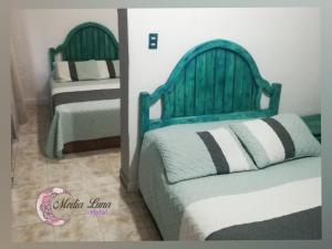 A bed or beds in a room at Hotel Media Luna