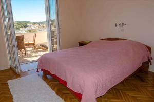 Posteľ alebo postele v izbe v ubytovaní Apartment Banjol 23