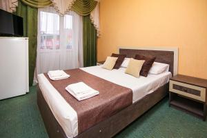 A bed or beds in a room at Гостевой дом Аида Витязево
