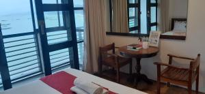A bed or beds in a room at A Place to Remember El Nido