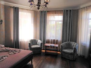 A seating area at Бутик отель Прованс