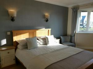 A bed or beds in a room at The River Haven Hotel