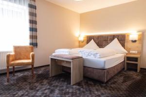 Ein Bett oder Betten in einem Zimmer der Unterkunft Land-gut-Hotel Landgasthof zur Rose