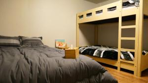 A bunk bed or bunk beds in a room at Chuls Lodge 2