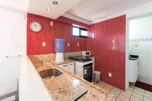 A kitchen or kitchenette at Boa Viagem Flat