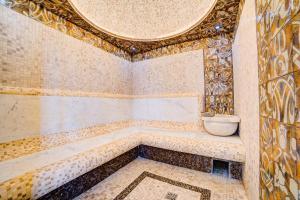 Ванная комната в Отель Усадьба Приморский Парк