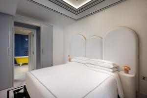 A bed or beds in a room at Arte by Thomas Chan