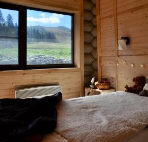 A bed or beds in a room at Motel Gora Krestovaya