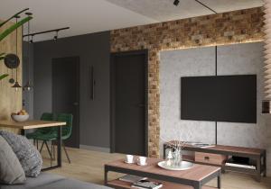 Telewizja i/lub zestaw kina domowego w obiekcie Loft Klonowa - Apartament z garażem