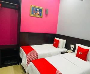 A bed or beds in a room at Ct Hotel