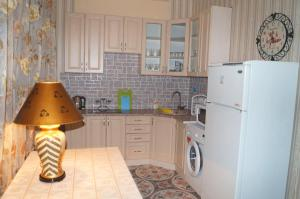 A kitchen or kitchenette at Cottages in Repino