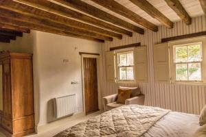 A bed or beds in a room at Silvermines Self Catering Accommodation