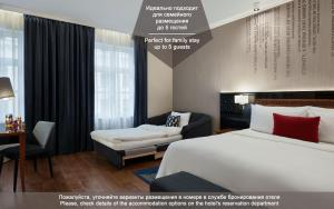 A bed or beds in a room at Renaissance St. Petersburg Baltic Hotel