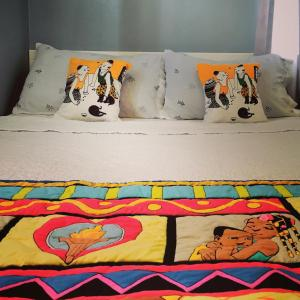 A bed or beds in a room at La Fuente House