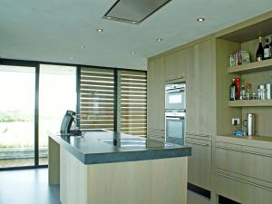 A kitchen or kitchenette at Quaint House Boat in Goëngahuizen with Sauna
