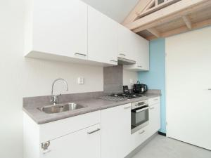 A kitchen or kitchenette at Holiday home @ Sea Lodges Bloemendaal 6