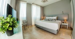 Un ou plusieurs lits dans un hébergement de l'établissement Oz Hotel Cartagena