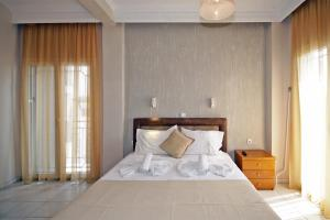 Ένα ή περισσότερα κρεβάτια σε δωμάτιο στο PortoDream Studios & Apartments