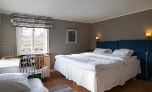Säng eller sängar i ett rum på Lilla Trulsabo