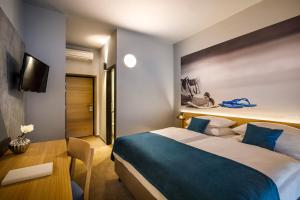 A bed or beds in a room at Hotel Istra