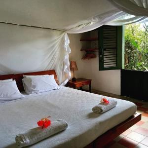 A bed or beds in a room at Casa Vila Do Outeiro
