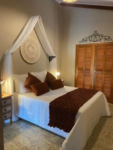 Cama o camas de una habitación en Vereda da Serra Eco Pousada