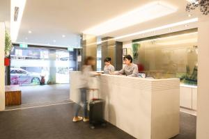 The lobby or reception area at Dandy Hotel - Tianjin Branch