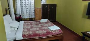 A bed or beds in a room at Cherry Guest House