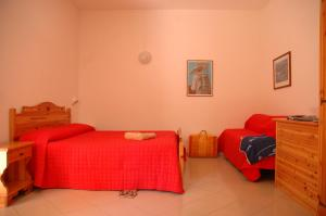 A bed or beds in a room at Residence Villa Tina
