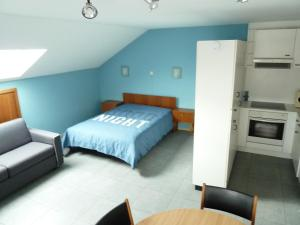 A bed or beds in a room at DODO DES ILES