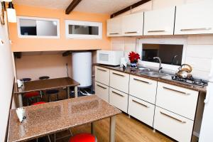 A kitchen or kitchenette at GL Hostel