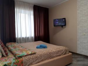 """Кровать или кровати в номере Apartment """" South"""""""