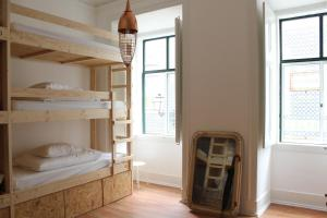 A bunk bed or bunk beds in a room at Lookout Lisbon Hostel