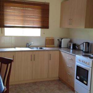 A kitchen or kitchenette at The Cook Cottage