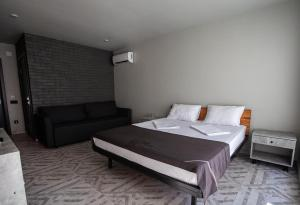 A bed or beds in a room at Hotel Pesok and More