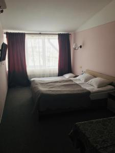 A bed or beds in a room at Hotel Bashnya