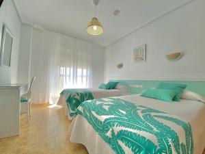 A bed or beds in a room at Hotel Blanca Brisa Cabo de Gata