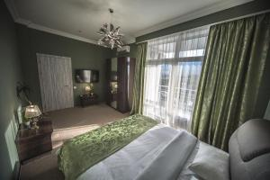 Кровать или кровати в номере санаторий Крымский гость