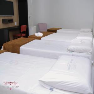 Cama ou camas em um quarto em Hotel Gaucha