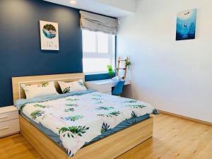 A bed or beds in a room at Tomorrow HomeStay Melody Vũng Tàu