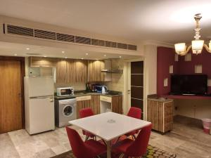 A kitchen or kitchenette at Monte Cairo Serviced Apartments