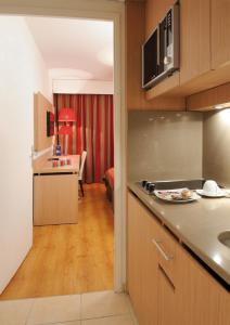 A kitchen or kitchenette at Residhome Paris-Evry