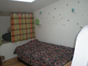 Un ou plusieurs lits dans un hébergement de l'établissement Maison du Chapitel