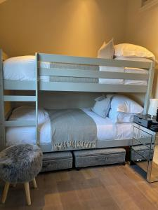 A bunk bed or bunk beds in a room at The Fuzzy Duck